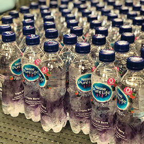 nestle pure life water bottles on production line