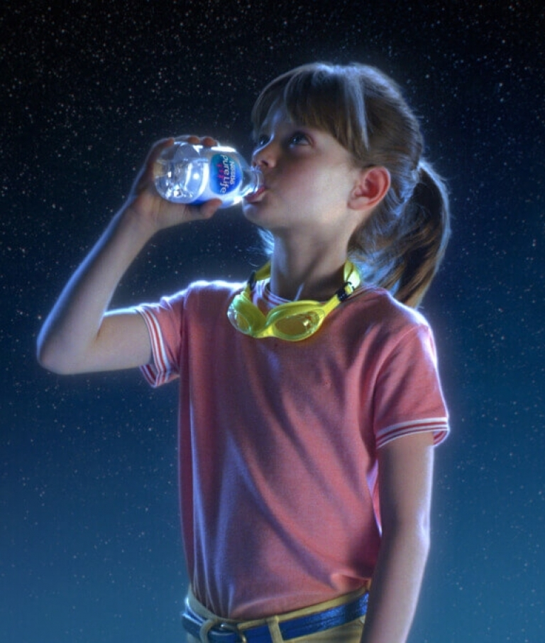 child drinking nestle pure life purified water in space looking at earth
