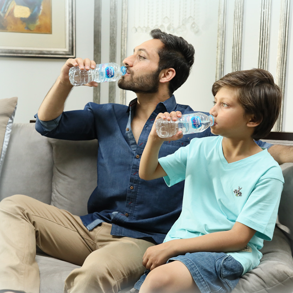 Family drinking Nestlé® Pure Life®